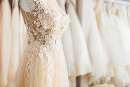 Elegant lace dress on dummy in wedding fashion shop Stockfoto