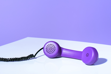 Plastic purple telephone handset, ultra violet trend Stock Photo