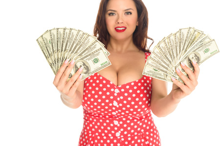 Beautiful plus size woman with lot of cash isolated on white background