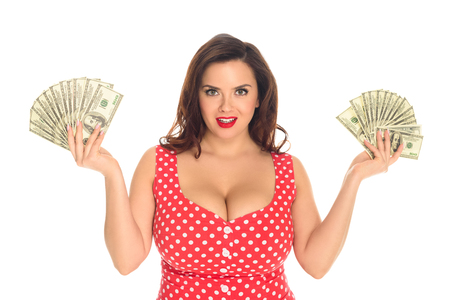 Smiling plus size woman with lot of cash isolated on white background