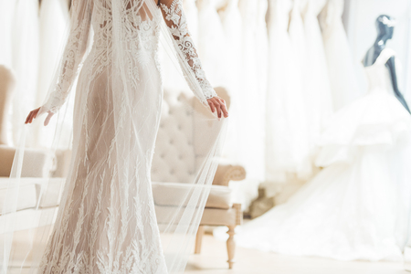 Cropped view of bride in lace dress in wedding salon 스톡 콘텐츠 - 112132994