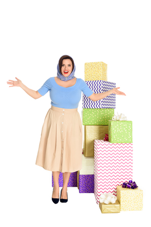Surprised stylish woman looking at camera while standing near presents isolated on white background Stock fotó