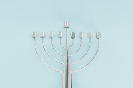 Top view of traditional menorah on blue backdrop, hannukah celebration concept Stock Photo