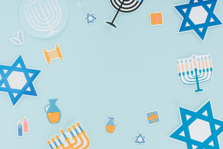 Flat lay with hannukah holiday paper signs isolated on blue, hannukah concept