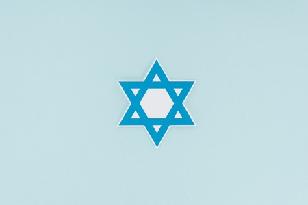 top view of traditional jewish star isolated on blue, hannukah holiday concept Stock Photo