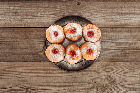 top view of sweet donuts on wooden tabletop, hannukah celebration concept Stock Photo
