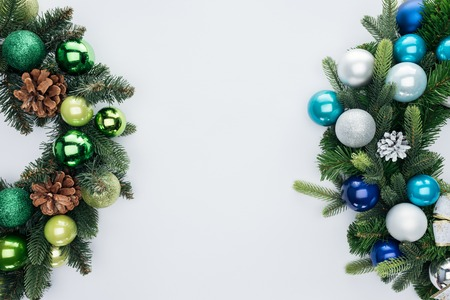 Top view of pine tree wreathes with green, blue and silver Christmas balls isolated on white background Stock Photo