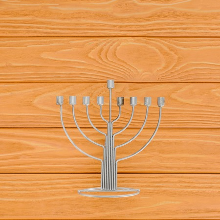 Top view of menorah on wooden surface, hannukah holiday concept Stock Photo