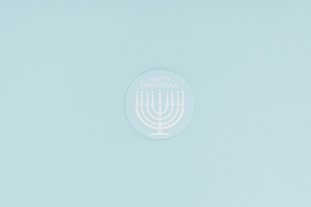 top view of happy hannukah card isolated on blue, hannukah concept