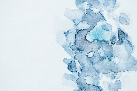Abstract background with blue watercolor blots