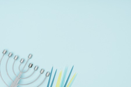 top view of menorah and candles isolated on blue, hannukah celebration concept Stock Photo