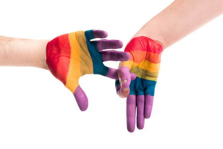 cropped image of gay couple showing penetration sign with hands painted in colors of pride flag isolated on white, world aids day concept