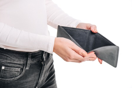 cropped image of woman opening empty black purse isolated on white Imagens