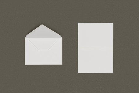 top view of open white envelope and blank card isolated on grey background Reklamní fotografie