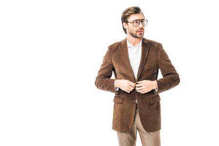 handsome male model in eyeglasses buttoning up velvet jacket isolated on white