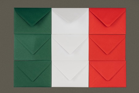 Flag of Italy made from green, white and red envelopes isolated on black