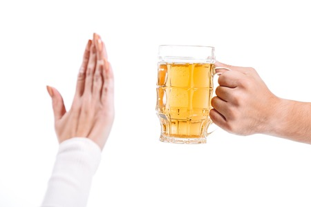 cropped image of woman rejecting glass of beer isolated on white Stock Photo