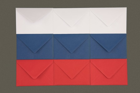 russia flag made from white, blue and red envelopes isolated on black Reklamní fotografie