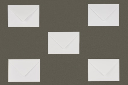 close-up view of closed white envelopes isolated on grey background Reklamní fotografie
