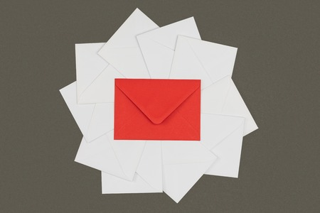 top view of red envelope and white cards isolated on black