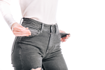 cropped image of girl showing empty jeans pockets isolated on white Imagens - 112222489