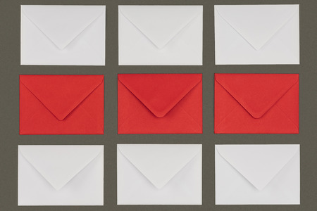 top view of closed red and white envelopes isolated on grey background Stock fotó