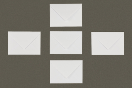 top view of white envelopes arranged isolated on grey background Stock fotó