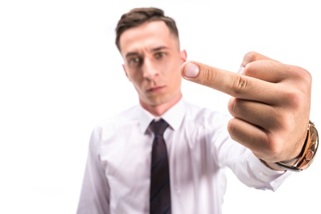 selective focus of angry businessman showing middle finger isolated on white