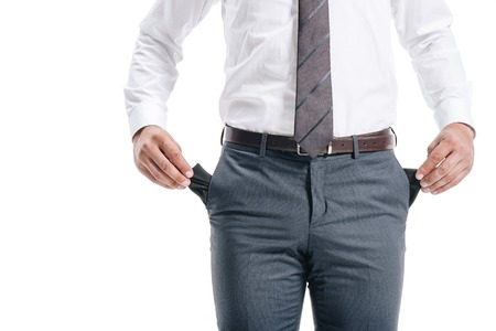 cropped image of businessman man showing empty pockets isolated on white Foto de archivo
