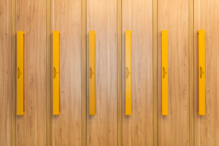 full frame view of wooden lockers with yellow handles in kindergarten Imagens