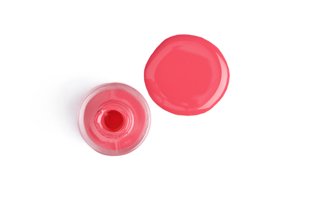 top view of pink nail polish and bottle on white background