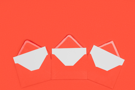 open red envelopes with white cards isolated on red