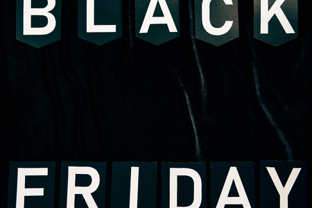 Top view of black Friday lettering on black background