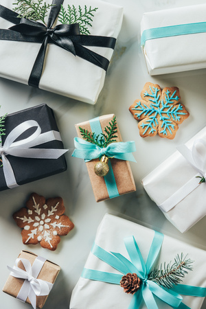top view of christmas gift boxes with snowflake cookies on marble table Stock Photo