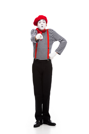 grimacing mime pointing on camera isolated on white