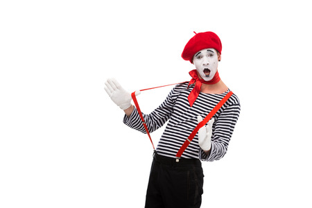 surprised mime with red suspenders isolated on white