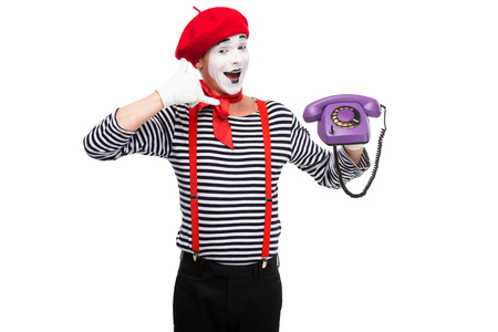 happy mime holding ultra violet retro stationary telephone and showing call me sign isolated on white Stock Photo - 111217306