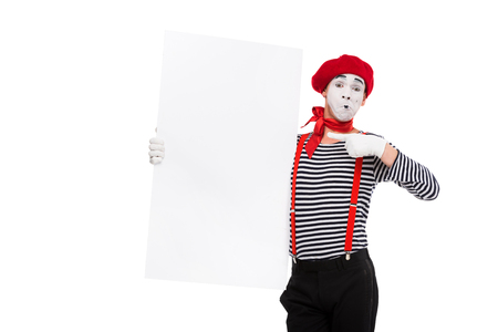 mime pointing on empty board isolated on white