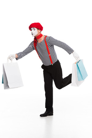 mime running with shopping bags isolated on white Stock Photo - 111229606