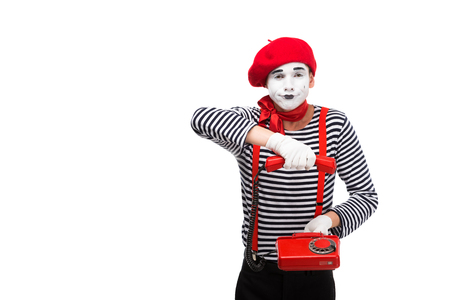 mime holding stationary telephone isolated on white
