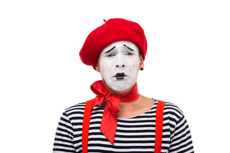 crying mime with red bow isolated on white