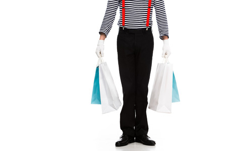 cropped image of mime standing with shopping bags isolated on white