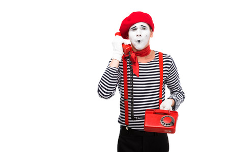 mime talking by stationary telephone isolated on white