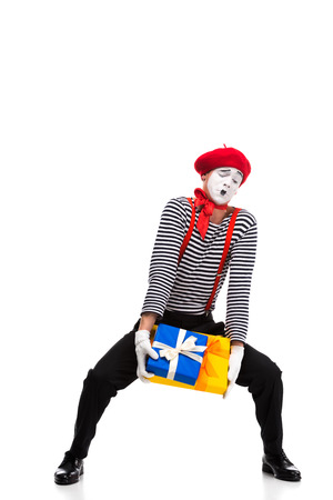mime holding heavy gift boxes isolated on white