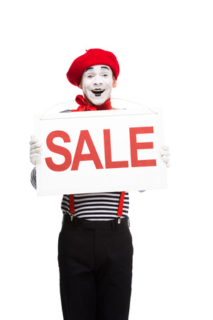 happy mime holding sale signboard isolated on white Stock Photo