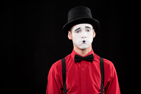 sad mime looking at camera isolated on black