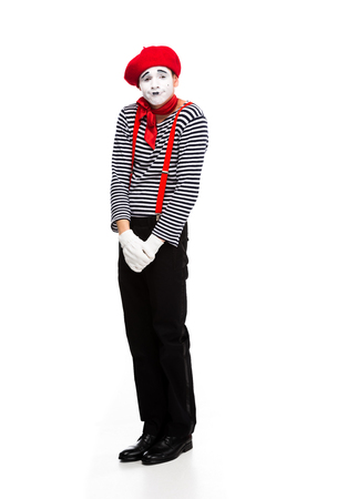 grimacing mime standing isolated on white Stock Photo