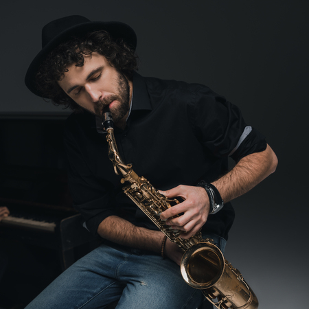 handsome young musician playing saxophone 스톡 콘텐츠 - 111366850
