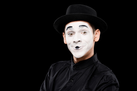 happy mime looking at camera isolated on black Stock Photo