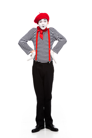 funny mime standing with hands akimbo isolated on white